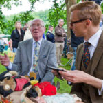 Mark Hill valuing stuffed toys at an Antiques Roadshow at St Fagans