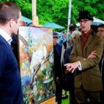 Mark Hill valuing a unique Tiffany panel at an Antiques Roadshow in Towneley Hall