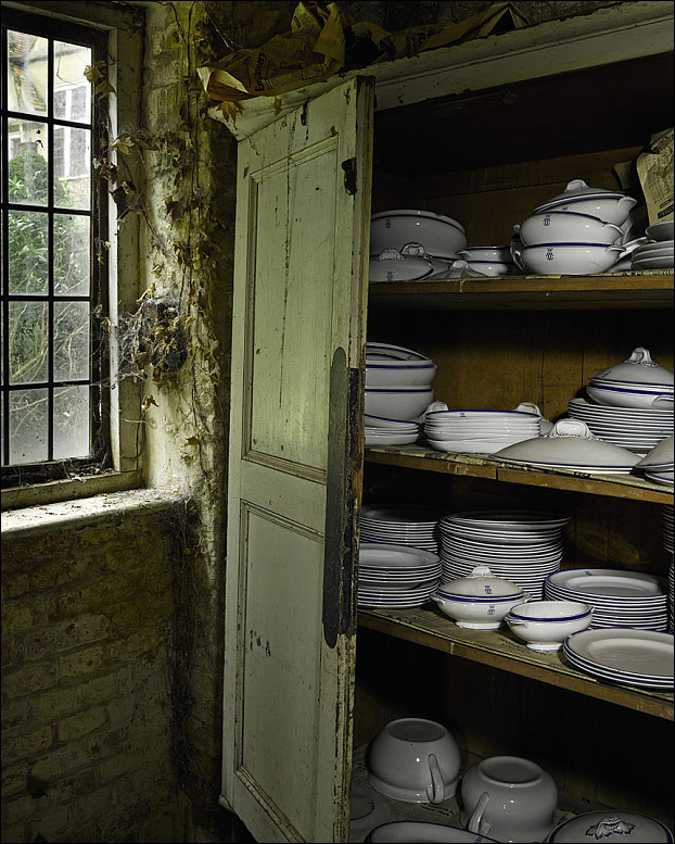 Property from the Estate of Mary, Duchess of Roxburghe. Ivy covered cupboard conceals engraved china dinner set.