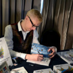 Mark Hill signing Czech glass books at the Cambridge Glass Fair