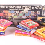 An early Atari 2600 'VCS' Video Computer System, with games and accessories - £165